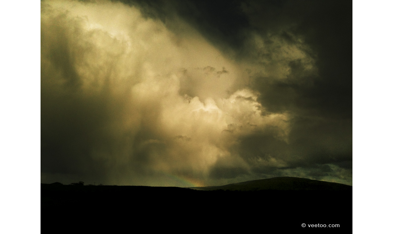 Irish landscape photograph of rainbow and storm clouds, Stranocum, County Antrim, Northern Ireland - photo 2410.