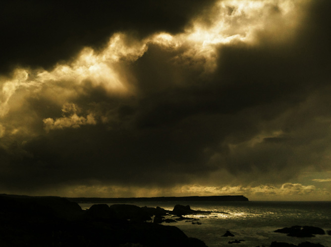 Irish landscape photograph of storm clouds over Ballintoy, Northern Ireland - photo 2413 photo icon.