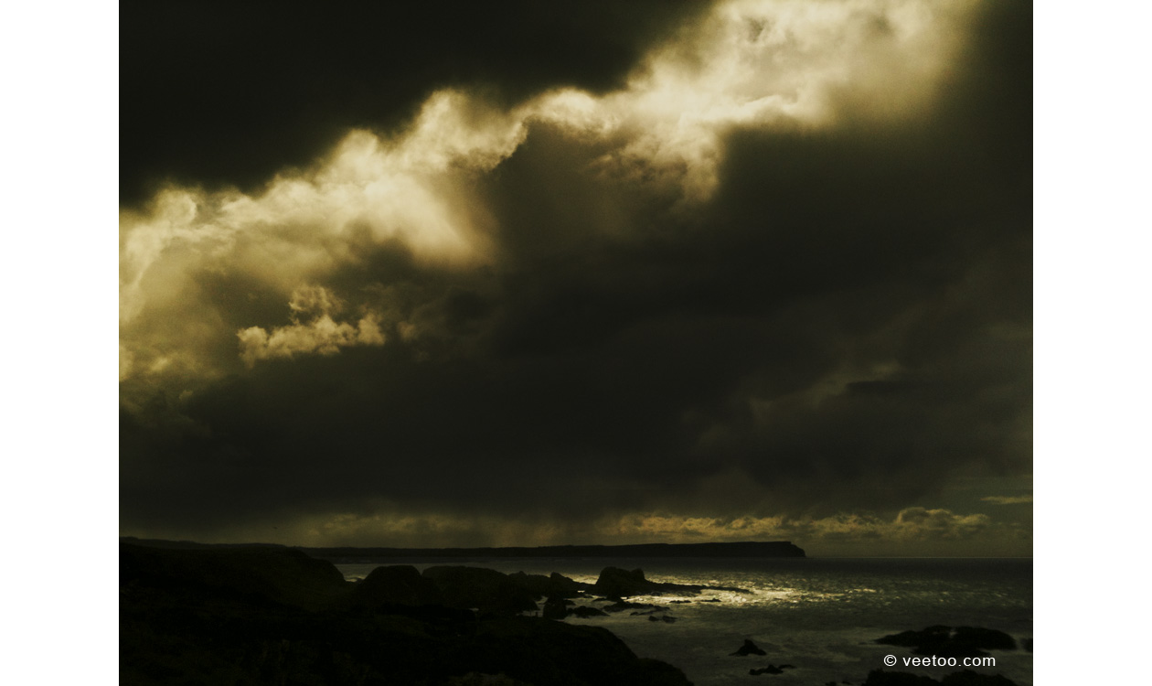 Irish landscape photograph of storm clouds at Ballintoy, Northern Ireland.
