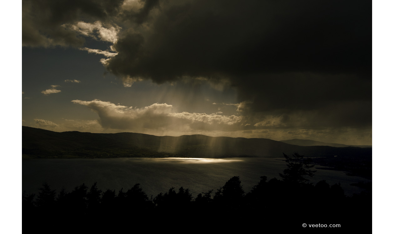 Irish landscape photograph of rain falling from storm clouds at Carlingford Lough, Northern Ireland.